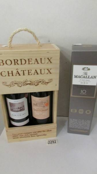 A boxed Macallan fine oak triple cash matured 10 year old whisky and 2 bottles of Chateau Bordeau.