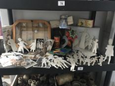 A collection of stencils, photo's, tins & display cabinet etc.