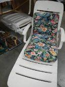 Two folding garden seats (no cushions).