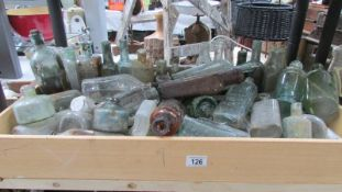 A large collection of glass bottles.