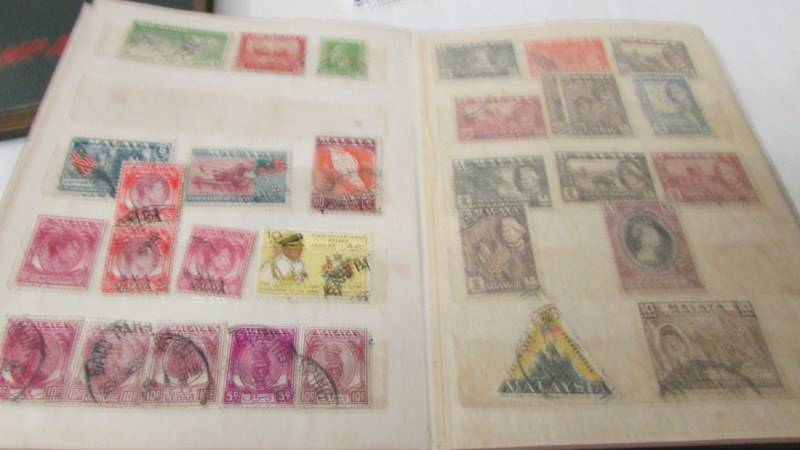 Two small albums of world stamps including India, China, Canada, UK etc. - Image 14 of 14