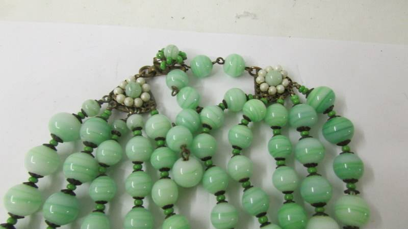 A Miriam Haskell five row necklace in a green colour, stamped Miriam Haskell. - Image 2 of 2