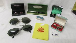 A mixed lot including cuff links, Parker pen, Lifeguard medal, vintage sun glasses etc.