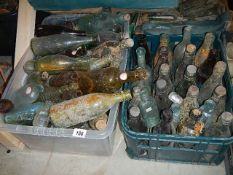 Two boxes of old dug up bottles, need a good clean.