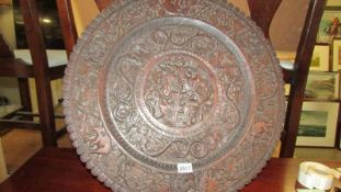 A superb oriental carved wood wall plaque featuring Deity's, elephants, serpents etc.
