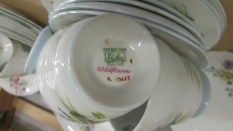 A Shelley tea set comprising teapot, sugar bowl, milk jug, 12 tea cups, 12 saucers, - Image 5 of 5