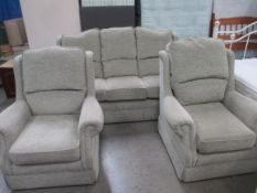 A 3 seater sofa and 2 arm chairs