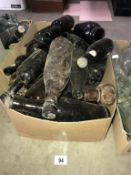 A box of brown 'name' bottles