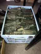 A crate of clear collectable bottles