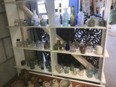 6 shelves of potion bottles