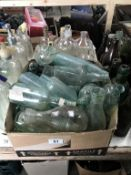 A large box of 'local' clear bottles 7 a tub of 'chemists' type bottles