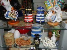Two shelves of assorted ceramics including novelty jam pots etc.