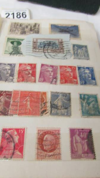 Two small albums of world stamps including India, China, Canada, UK etc. - Image 9 of 14