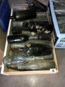 A box of vintage bottles