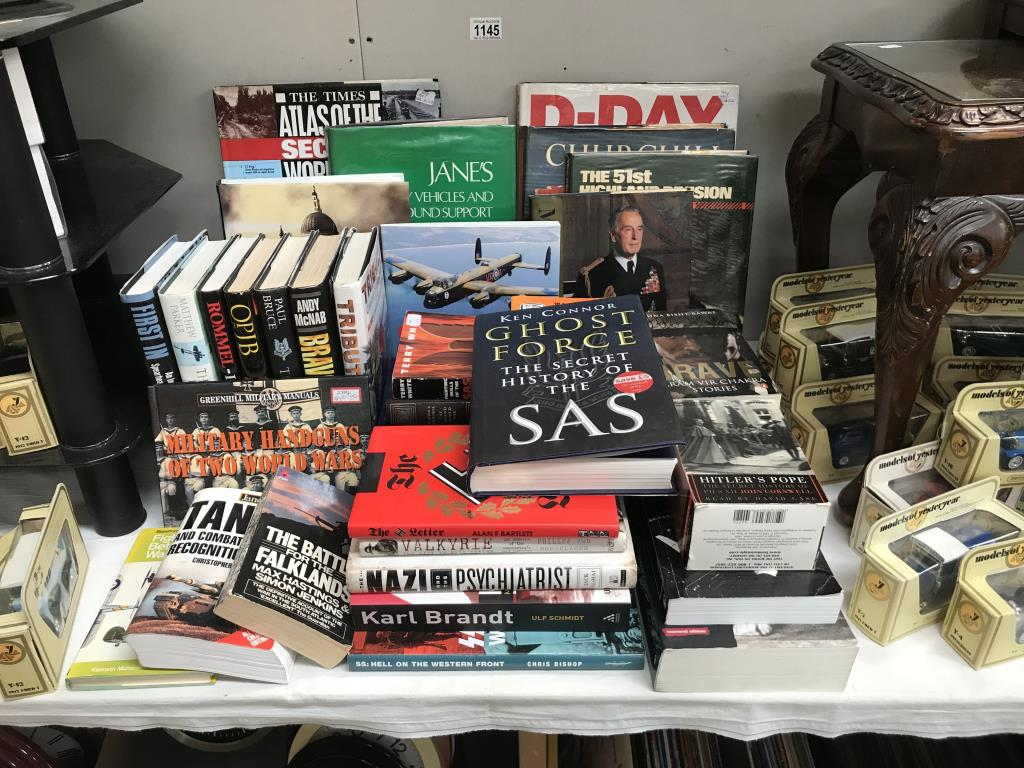 A good lot of war related books including 'Ghost Force' the secret history of the SAS,
