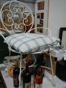 A good scrolly iron chair.