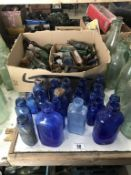 A large collection of blue glass & a box of various small potion bottles