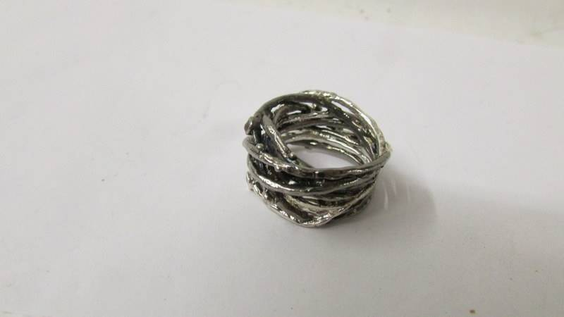 A designer set diamond ring in a twisted white metal design, size O. - Image 2 of 2