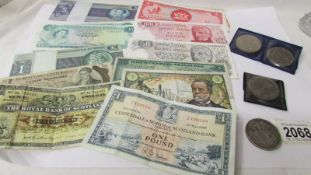 A quantity of old coins and banknotes.