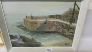 An oil on board painting of Lamorna Cove, Cornwall and dated J C Wootton, autumn 1968.