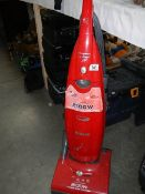 A Hoover upright vacuum cleaner.