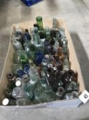 A box of coloured decorative bottles