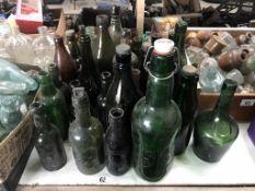 A good lot of larger green/brown bottles/jars