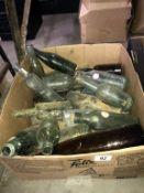 A box of clean vintage bottles