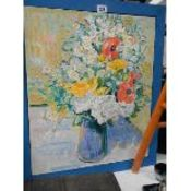 A framed oil painting of a floral arrangement.