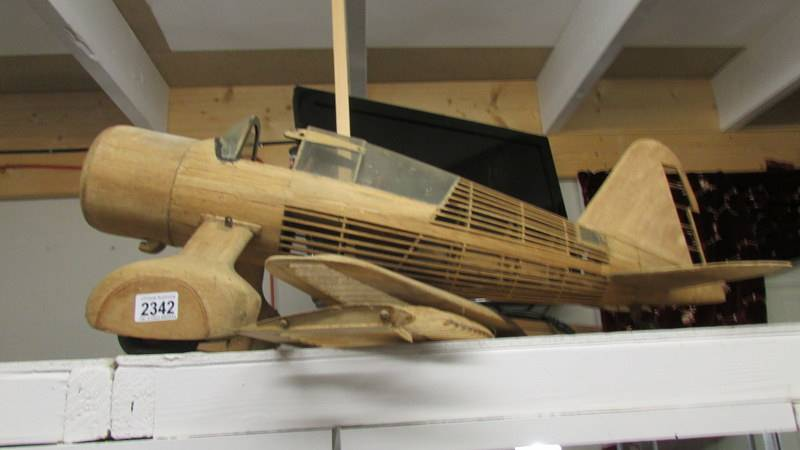 A part built model aircraft in wood (Westland Lysander).
