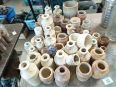 A large collection of glazed pots