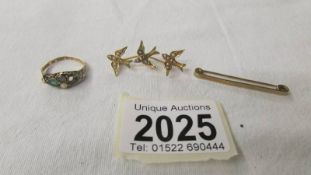 An 18ct gold ring (missing one stone) 1.6 grams, a 9ct gold tie pin, 1.