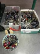 A large quantity of unsorted costume jewellery (2 boxes)