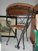 A Wrought iron chair and matching hall table.