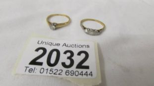 An 18ct gold ring set (2.3 grams) and an 18ct gold diamond solitaire ring (2.5 grams).