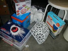 A large box with hand held vacuum cleaner, assorted cleaning items, space saving vacuum bags,
