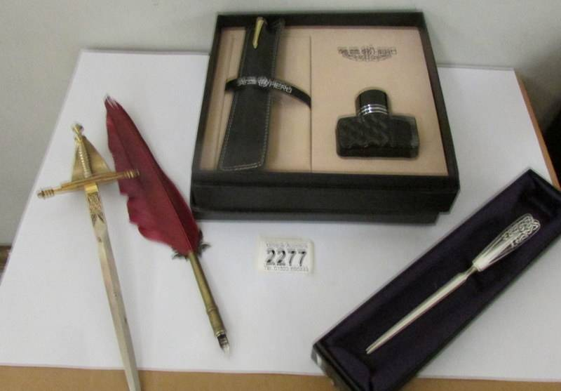 2 letter openers, a quill pen and a 'Hero' pen and ink gift set.