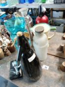 A collection of 50's/60's soda syphons, shakers & jug etc.