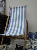 A vintage wooden deck chair.