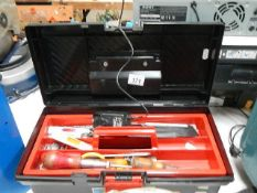 A tool box with assorted tools.