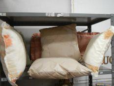 A Shelf of cushions.