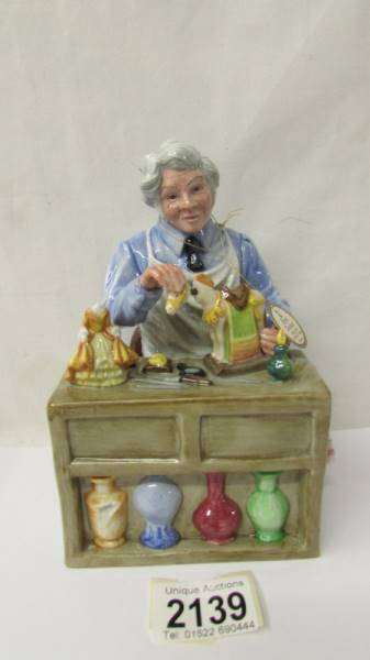 A Royal Doulton figure - The China Repairer HN2943.