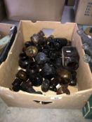 A large box of brown glass