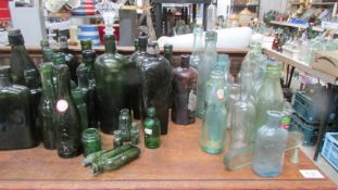 A quantity of glass bottles.