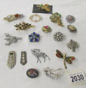Approximately 18 assorted brooches including micro mosaic, stag, vintage etc.