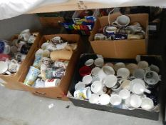 Three boxes of assorted mugs including promotional.