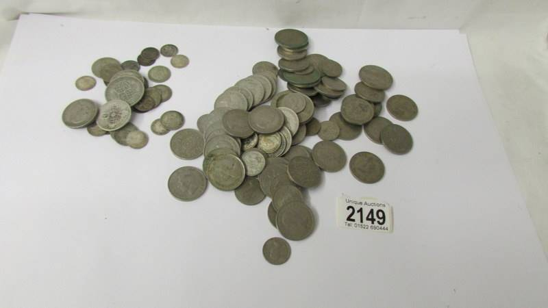 A mixed lot of coins including 110 grams of silver.