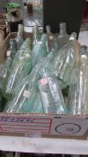 A box of clean bottles with makers names.