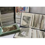 Three small albums of Edwardian and later postcards.