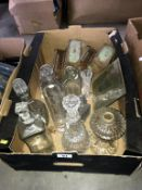 A box of mainly cut glass decanters